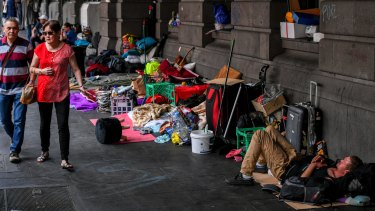 A large homeless camp outside Flinders Street Station.