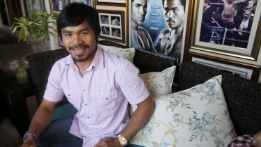 Filipino boxer Manny Pacquiao smiles during a news conference at his mansion in General Santos city in southern Philippines in 2010. Pacquiao has been an inspiration for millions of Filipinos not just as a boxer, but as a philanthropist.