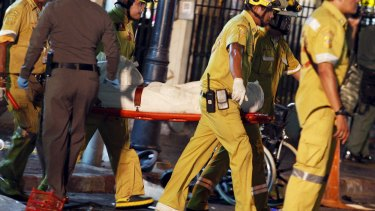 Rescue workers carry the body of a victim from the Erawan shrine.