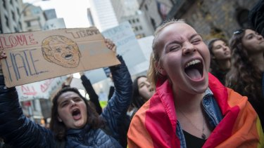 Ellen Marius, right, and Majo Orozco chant slogans as they demonstrate during a rally outside Trump Tower in New York.