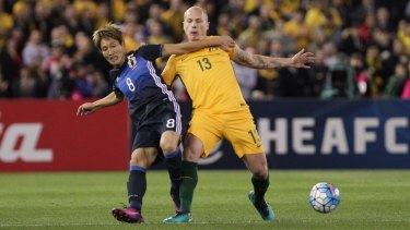 Rematch: Aaron Mooy and Japan's Genki Haraguchi battle hard for the ball during last year's World Cup qualifier in Melbourne.