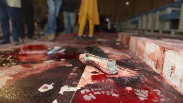The bloodied ceremony hall at the school the day after the attack.