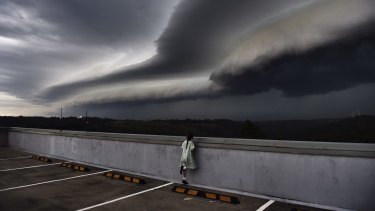 Cleopatra Moir watches as shelf cloud rolls into Sydney.