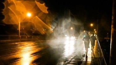 Bill Shorten during an early morning run in the rain in Melbourne.