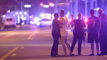 Orlando Police officers direct people away from a multiple shooting at the nightclub.