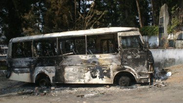A bus torched in protests by Naga tribesmen over the election, due on February 1 but postponed.