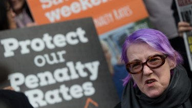 Hospitality and aged care worker Maire O'Connor protests on Collins Street, Melbourne.