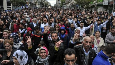 People march in protest at an explosion that killed scores of people in Ankara.