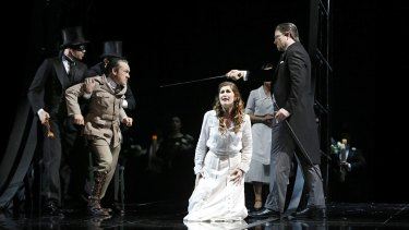 Darkly moving: Michael Honeyman (Miller), Nicole Car (Luisa) and David Parkin (Walter) in the Melbourne season of Opera Australia's Luisa Miller.