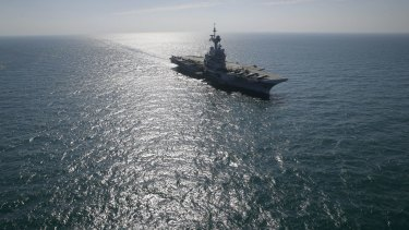 France's flagship Charles de Gaulle aircraft carrier navigates in the Persain Gulf as part of the US- led coalition against the Islamic State group, conducting airstrikes in Syria earlier this month.