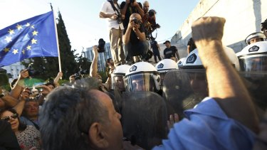 Pro-EU protesters scuffle with riot police outside the parliament building during a rally calling on the government to clinch a deal with its international creditors and secure Greece's future in the Eurozone, in Athens, Greece.