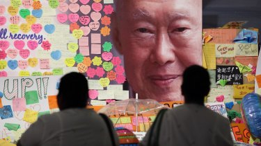 Hospital staff mourn the death of Lee Kuan Yew outside the Singapore General Hospital.