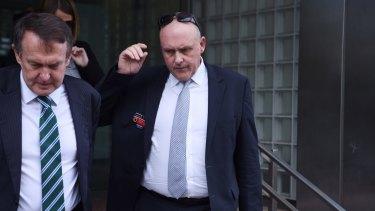 Detective Inspector Matt Kehoe, right, leaves the NSW Coroner's Court on Wednesday.