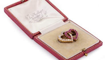 A Russian ruby and diamond brooch.