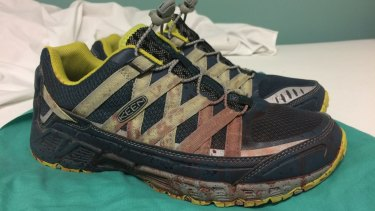 Dr Corsa's shoes were left spattered with blood, which he says will stain him forever.