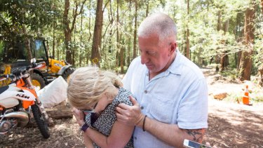 Mark Leveson comforts his wife, Faye, as the search for their son Matthew's body in the Royal National Park is called off.