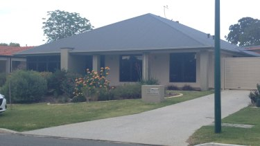 Another example of a new home in Perth with a black roof and little shade.