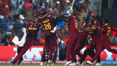 World champions: West Indies players celebrate victory after Carlos Brathwaite hit the winning runs in the final against England in Kolkata last April.