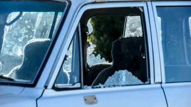 One of several vehicles that had their windows smashed at Canberra Railway Station on Thursday.