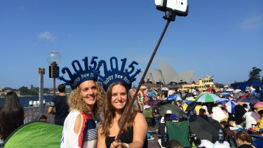 Lisa Gelz and Isabelle Horber, tourists from Switzerland, finding the best angles with their selfie stick.