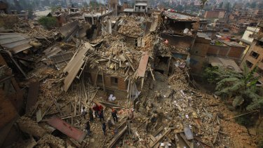 Rescuers at work in the town of  Bhaktapur after April's earthquake.