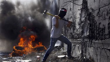 Unrest: A Palestinian student tries to break the separation barrier between the West Bank and Israel.