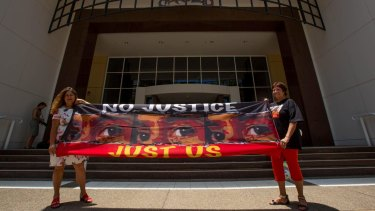 Protesters Theresa Rowe (left) and Josephine Crawshaw outside the royal commission in Darwin.
