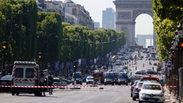 Police forces secure the area on the Champs Elysees in Paris.