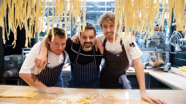 Chef Eugenio Maiale (centre) of Flour Eggs Water by A Tavola at home in the refurbished Harold Park Tramsheds.
