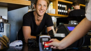 Kingston's TwoforJoy staff member Luka Markulin and a customer using a contactless payment option.