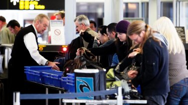 Beefing up security: $293 million will be put towards more officers, dogs and full-body scanners at major airports.