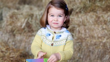 Princess Charlotte appears to be thrilled at the prospect of her impending second birthday in this new photo taken by her mother, the Duchess of Cambridge.