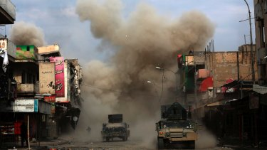Three roadside bombs laid by Islamic State group militants explode in western Mosul earlier this month.
