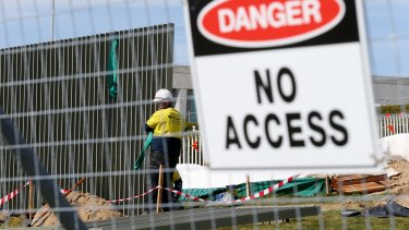 The security fence being installed across the lawns of Parliament House this week.