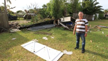 Kurnell resident Bill Byast shows the storm damage in his backyard.