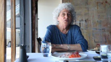 Marion Nestle prepares to tuck into the interviewer's sashimi.