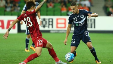 Huan Fu of Shanghai SIPG challenges Jai Ingham of Melbourne Victory during the AFC Asian Champions League match on Wednesday.
