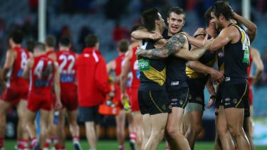 Nathan Gordon and Dustin Martin celebrate victory during the round 23 match against the Swans.