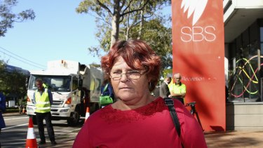 Mt Druitt resident and <i>Struggle Street</i> subject Peta Kennedy stands outside SBS as rubbish trucks blockade the broadcaster in protest.