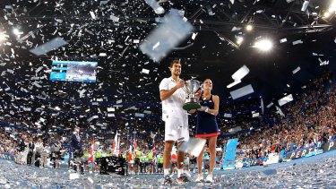 Glittering affair: Poland's Jerzy Janowicz and Agnieszka Radwanska celebrate their win.