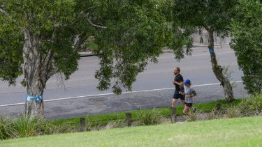 Joggers on Campbell Road, St Peters, in the part of Sydney Park that will be acquired as part of the WestConnex project.