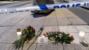 Candles and flowers are placed near the site of the attack.