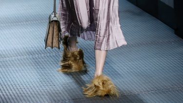 In this Wednesday, January 5, 2015 file photo, a model wears footwear with wisps of fur as part of the Gucci women's Fall-Winter 2015-2016 collection, in Milan, Italy.