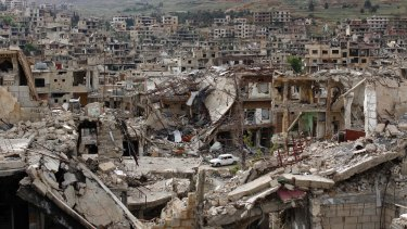 Zabadani, outside Damascus, on May 18. The Syrian civil war started in 2011 and is ongoing, causing many people to flee.