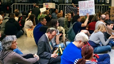 Demonstrators stage a sit-in at San Francisco International Airport.