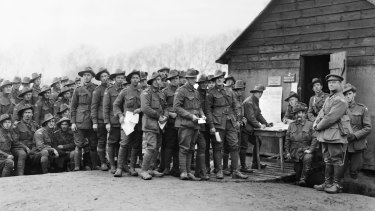 The soldiers' vote: men of the 44th Battalion cast their ballots; conscription referendum, Belgium, December 8, 1917.