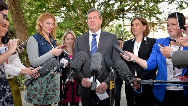 Victorious LNP leader Tim Nicholls speaks at a press conference with new deputy Deb Frecklington (right) following the spill.