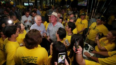 Prime Minister Malcolm Turnbull and Barnaby Joyce celebrate his re-election with National party supporters.