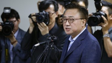 Koh Dongjin, president of Samsung's mobile division, speaks at a news conference in Seoul.