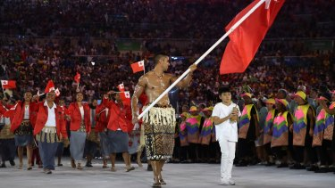 Pita Nikolas Aufatofua of Tonga carries the flag during the Opening Ceremony of the Rio 2016 Olympic Games at Maracana Stadium on August 5, 2016 in Rio de Janeiro, Brazil.